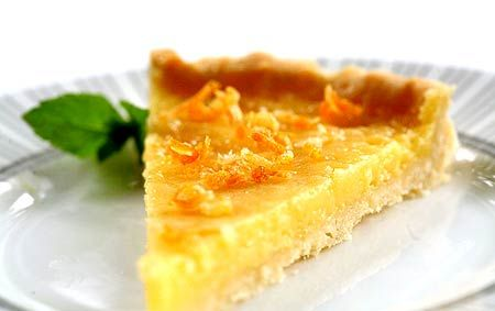 Positively scrumptious lemon tart with lemon curd, candied lemon peel, and an almond-hinted shortbread crust.