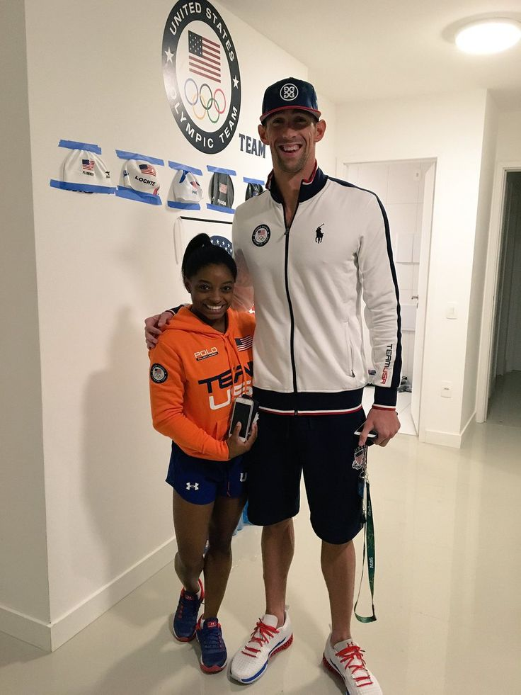 Phelps and Biles | Simone looks like she could be his daughter!!! LOL