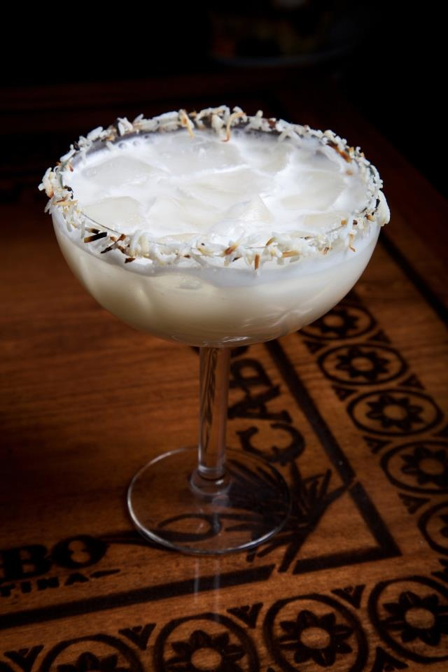 """Cabo Wabo Cantina's """"Coconut Margarita."""" Ingredients: Resposado tequila, cream of coconut, pineapple, sweet & sour, Triple Sec & toasted coconut!  Cabo Wabo Cantina Las Vegas is located on the Strip at the North entrance to the Miracle Mile Shops at the Planet Hollywood Hotel & Casino"""