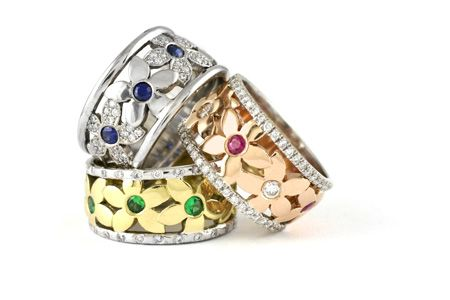 18k Gold custom designed Daisy rings set with Diamonds and a variety of precious coloured stones.