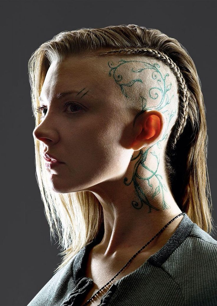 Natalie Dormer as Cressida in Mockingjay - Wow. There are very few women capable of pulling off a look like this, and yet, Natalie STILL looks beautiful! O.O