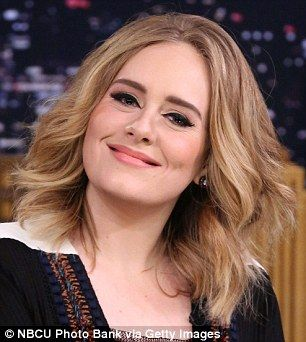 Luscious locks: Adele's hair flows naturally for a US TV chat show appearance