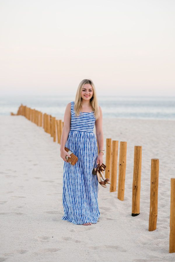 Bows & sequins. Blue and white striped maxi dress+brown ankle strap heeled sandals+straw clutch+tassel earrings. Summer Casual Dinner Outfit 2017