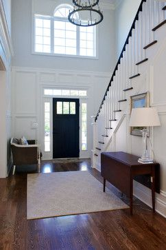 Bought a house with a 2-story foyer (not a fan) but this wainscoting idea might do the trick.