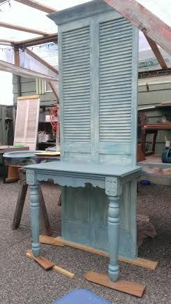 Louvered doors and some old table legs a little crown mold and we have a ...r
