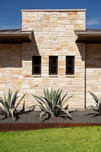 Love this elevation with the stonework, the 3 windows and the succulant plants