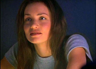 I pictured Kristen Cloke (Shane from 'Space: Above and Beyond') as Caren Johnson.  This particular picture is very much what I imagine Caren would look like.