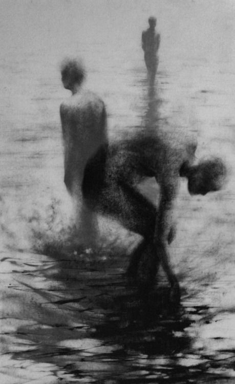 "Clara Lieu, ""Unseen I"", lithographic crayon on Dura-Lar, 48"" x 30"", 2009. This drawing is from ""Wading"", a project that presents the most severe form of isolation as loneliness that is experienced when physically surrounded by other people.  These works depict figures wading in an infinite and undefined body of water.  I visually portray loneliness as the experience of feeling unseen and unknown within a group."