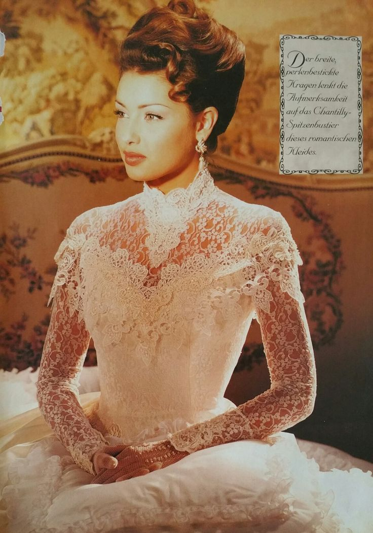 Demetrios special collection 1994    Brocade dress with pearl embroidered high neck and a Chantilly lace bustier