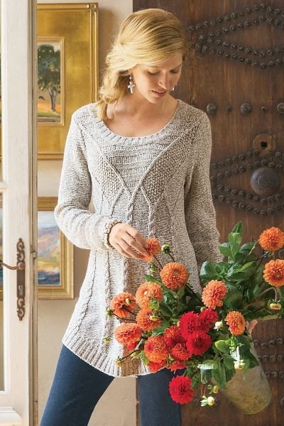 Gleaming silver threads give our Cortina Sweater a luxe look! A sexy skin-showing neckline complete the not-too-bulky design.