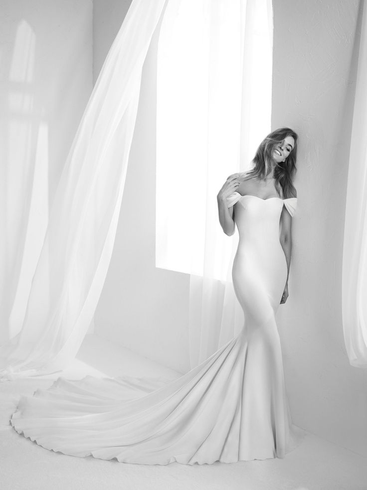 Raciela: Very accentuated mermaid style strapless wedding dress. Elegant and simple design with an air of romance. Detachable cap sleeves. - Pronovias