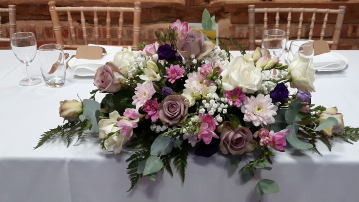Top table arrangement.  Amnesia roses.  Eucalyptus and freesia.