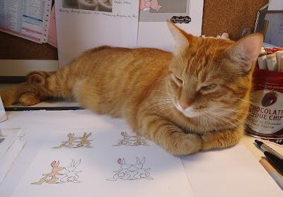 Shamus plops himself on my desk while I'm working at it.I M Work, Shamus Plopping