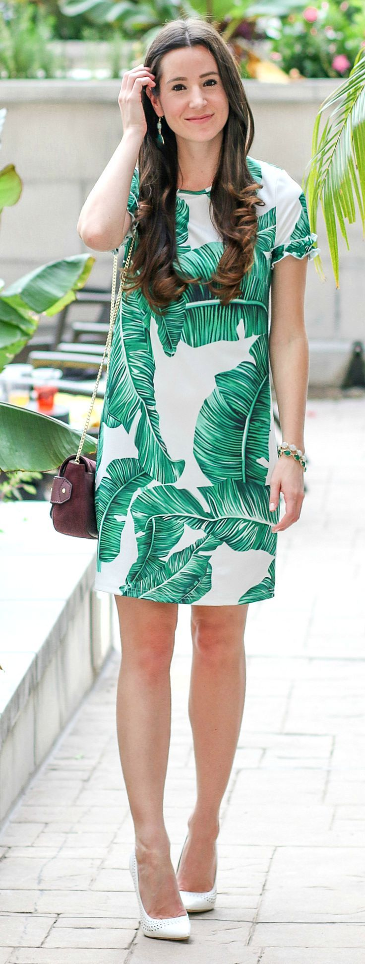 Palm Print Shift Dress with white pumps, Vera Bradley Carson Mini Saddle Bag in Sycamore Bittersweet Chocolate, green and white drusy Kendra Scott Brynn bracelets, and green gemstone drop earrings-- affordable vacation outfit idea | Italian Girl Problems: How to Add Volume to Second Day Hair by blogger Stephanie Ziajka from Diary of a Debutante