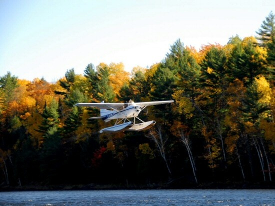 Cessna 180 departs Partridge Lake on a beautiful Fall day