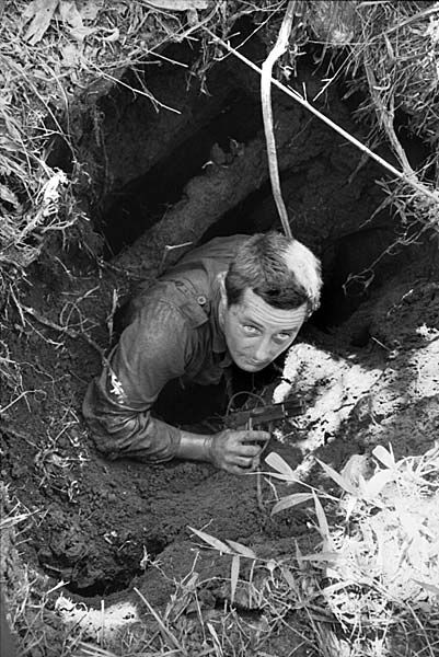 'Tunnel rat' Lance Corporal Ron Rockliffe 6RAR, of Campsie, NSW, prepares to drop into a Viet Cong tunnel during Operation Enoggera, June 1966. [AWM CUN/66/0525/VN]