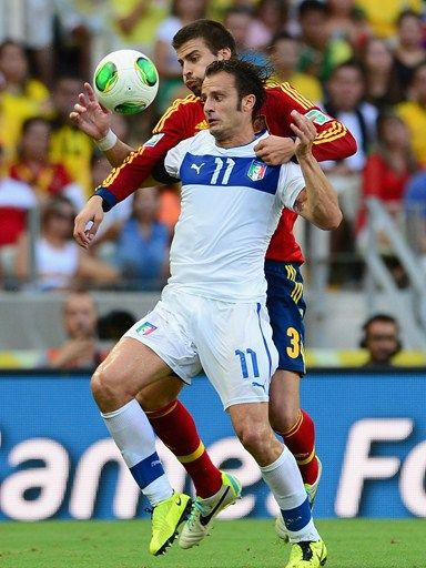 Gerard Pique of Spain battles with Alberto Gilardino of Italy during the FIFA Confederations Cup Brazil 2013 Semi Final match between Spain and Italy at Castelao on June 27, 2013 in Fortaleza, Brazil. (Photo by Buda Mendes - FIFA/FIFA via Getty Images)