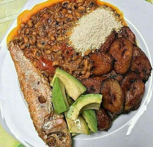 Red oil beans with fried plantain gari pear and fried fish