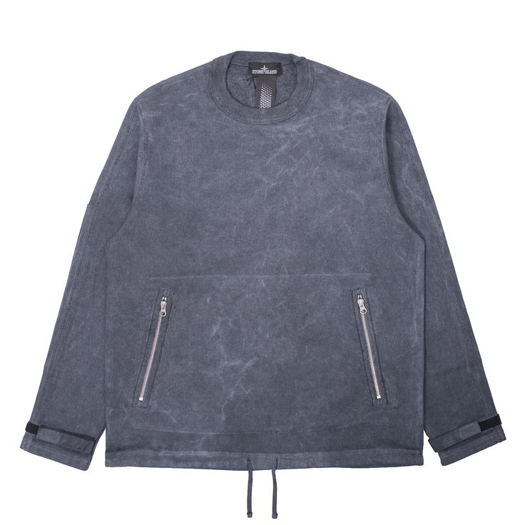 Stone Island Shadow Textured Crewneck Sweatshirt in comfort brushed textured cotton. Garment dyed and then treated with the Fallout Colour pigment over dye; this special treatment results in garments with a unique future vintage look. Ribbed neckline. Pouch pocket with two diagonal openings with zip fastening on cotton tape. Long rectangular patches on the elbows. Waistband in cotton ribbon and Velcro at cuffs. Raglan sleeves and vertical central seam on back. Bottom drawstring.