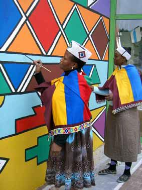 Colorful Ndebele style art - geometric building art painting by women, has a…