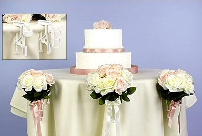 using bouquet holders - using flowers around the table instead of on the table