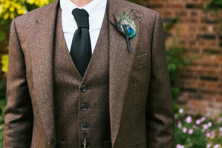 Groom wears a three piece brown suit | Photography by http://www.lmcguinessphotography.co.uk/