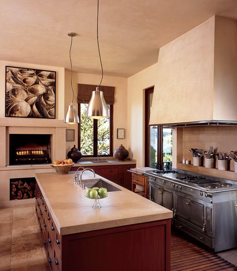 fireplace + limestone in french country kitchen