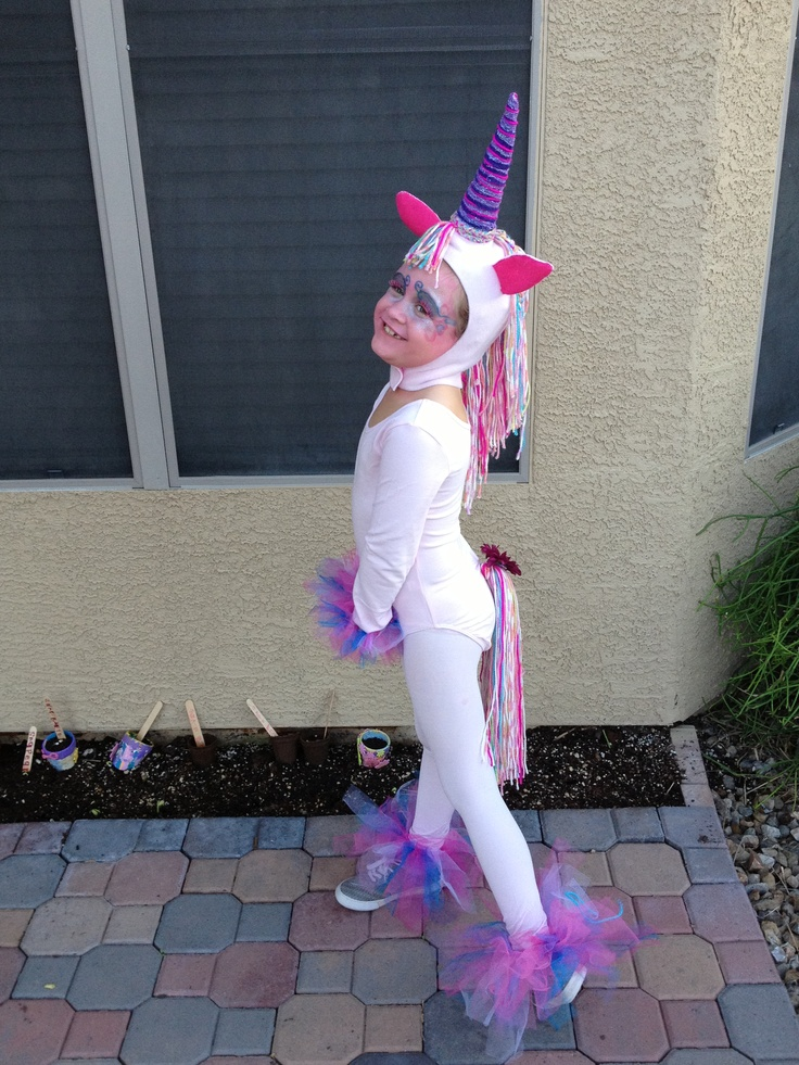 Unicorn costume. Streamers. Tutus on hands and feet.