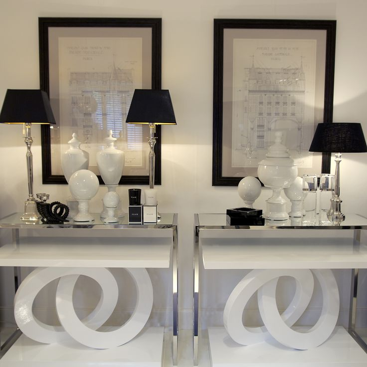 Black And White Vignette With Architectural Prints Crystal Lamps Chrome Glass Tables
