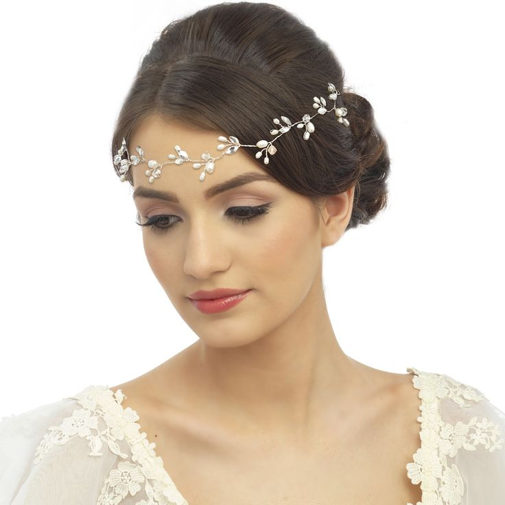 These beautifully designed, luxury headpieces, hair vines and headbands available in store now. Can be purchased or hired. CHIC FRESHWATER PEARL HAIRVINE - Chic and elegant crystal hair vine - with freshwater pearls and high quality crystals on a silver finish