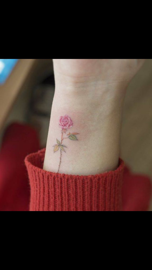 Small rose tattoo on wrist