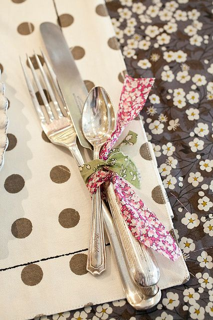 Vintage silverware found at a flea market –  polished and placed on the table tied together with scrap Liberty fabrics. Pretty <3