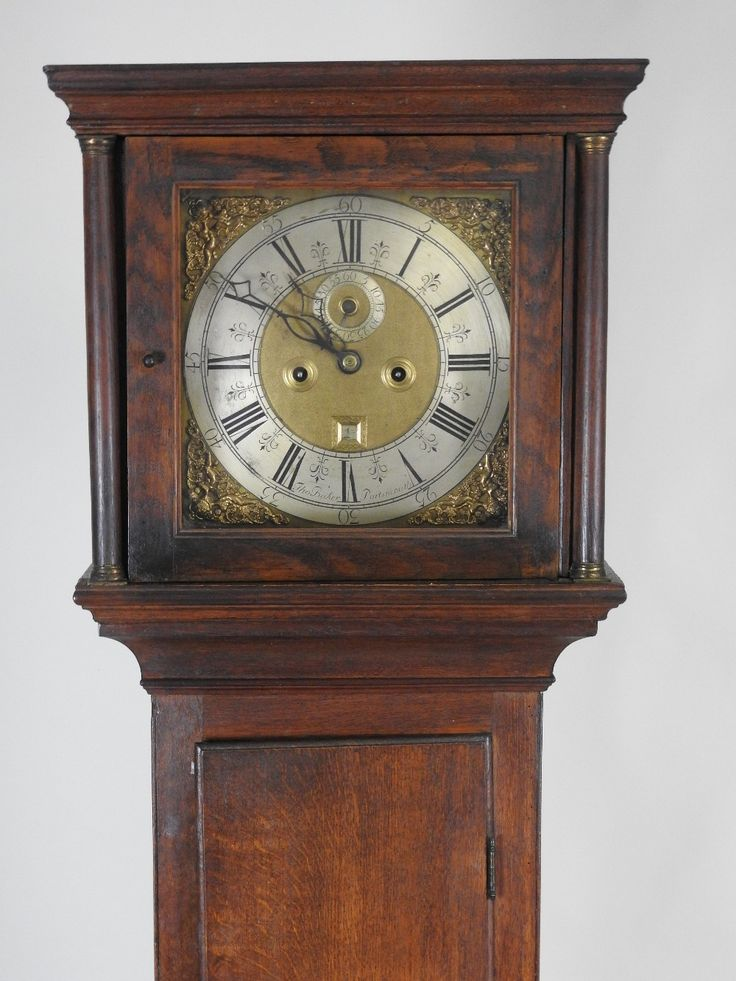 An 18th Century Oak Eight Day Longcase Clock, The 12 Inch Square Brass Dial  Signed Tho Baker, Portsmouth, With Centred Subsidiary Seconds Dial And Date  ...