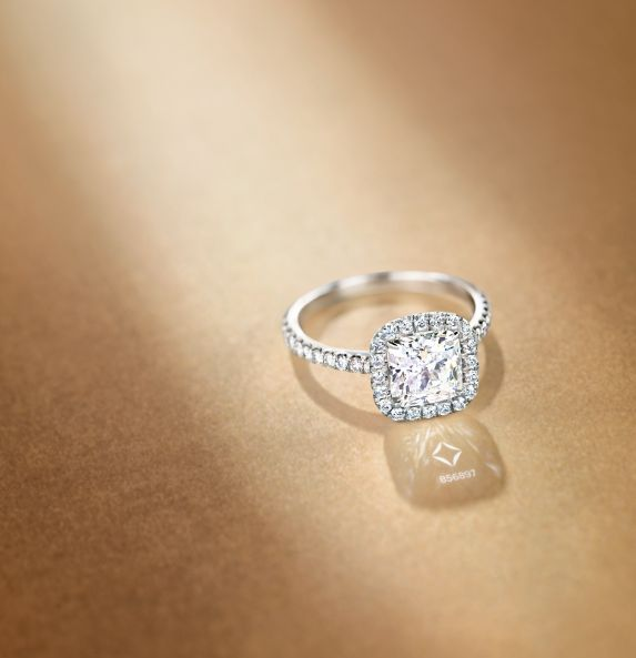 The ultimate gift? Getting engaged with The Center of My Universe™ Cushion Halo diamond ring featuring a Forevermark diamond. Each one is inscribed with a unique number that indicates that each one upholds the highest standards.