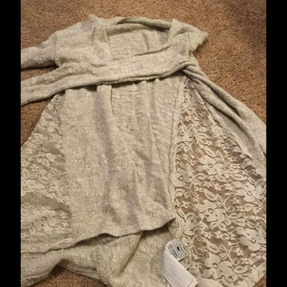 Abercrombie kids girl's sweater cardigan Abercrombie kids. Girls sweater. Lace sides. Tag has been cut out. Excellent used condition. Abercrombie kids Sweaters Cardigans