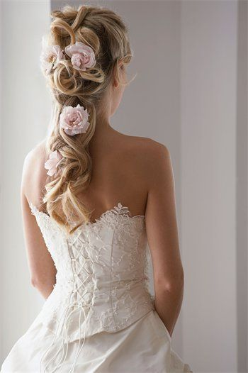 Long ponytail adorned with roses {Vendor: The MAC Studio}