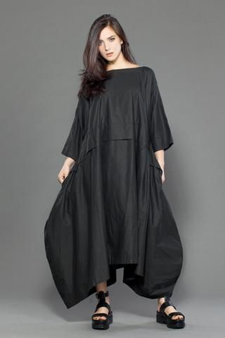 We love this dress!! The beauty of this oversized piece is the draping created by its volume. Made of a sheer voile fabric that can be worn year round -- perfec