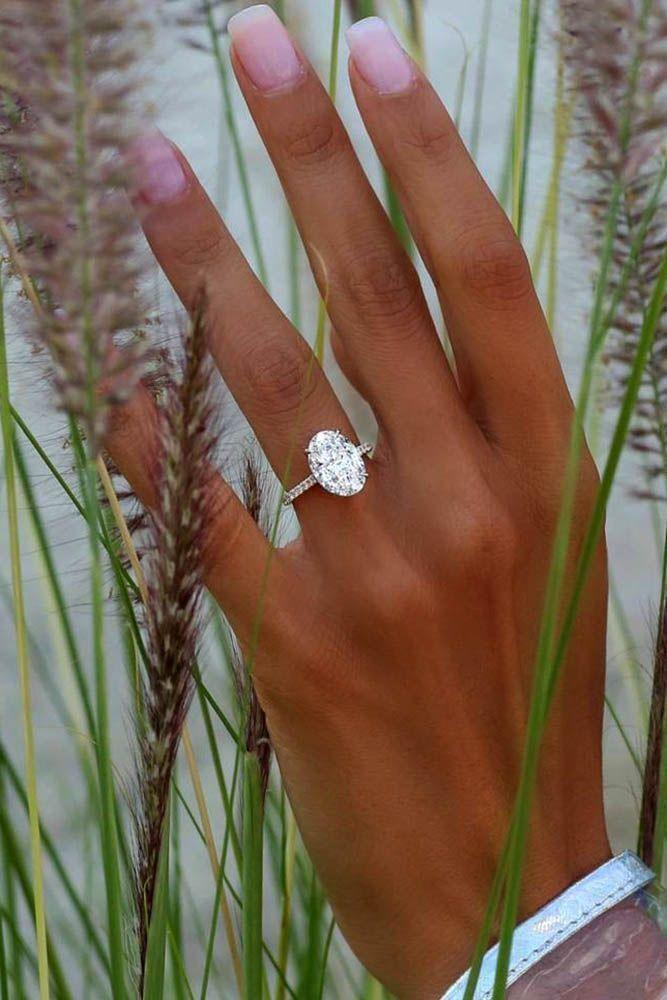 24 TOP Engagement Ring Ideas ❤️ top engagement ring ideas simple oval ❤️ See more: http://www.weddingforward.com/top-engagement-ring-ideas/ #wedding #bride #weddingring #DazzlingDiamondEngagementRings #ClassyWeddingIdeas