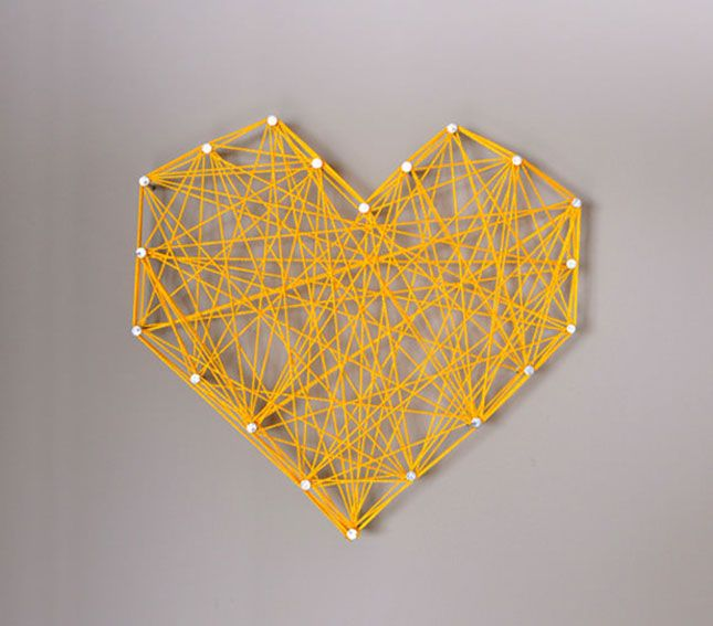 Go ahead and nail your string art directly into the wall.