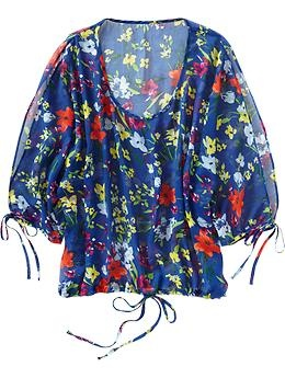 Old Navy Floral Top in white, not blue. Never shop here, but i am liking what i see.