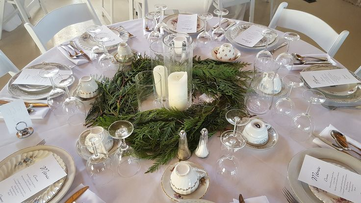 Sparkling evergreen centrepieces and quaint mis-matched vintage place settings at this winter wonderland January 2018 wedding reception in Ruthven Park's Coach House.