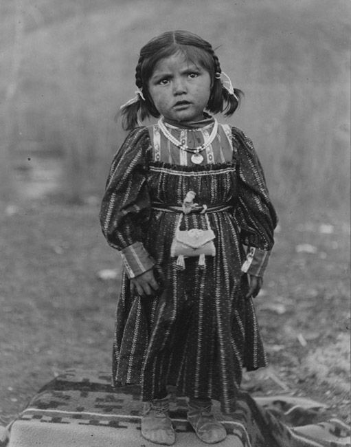 1906 photo of Nez Perce Nimiipu native little girl. Photo taken by E. H. Latham in Colville, Washington.