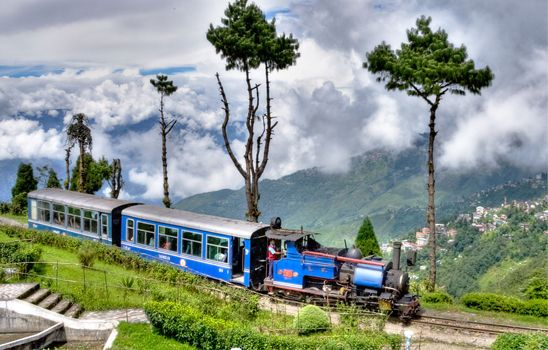 "The Darjeeling Himalayan Railway - also known as the ""Toy Train"", is a 2 ft narrow gauge railway that runs between New Jalpaiguri and Darjeeling in West Bengal."