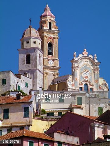 Church towers domin ate the skyline of the town of... #laigueglia: Church towers domin ate the skyline of the town of… #laigueglia