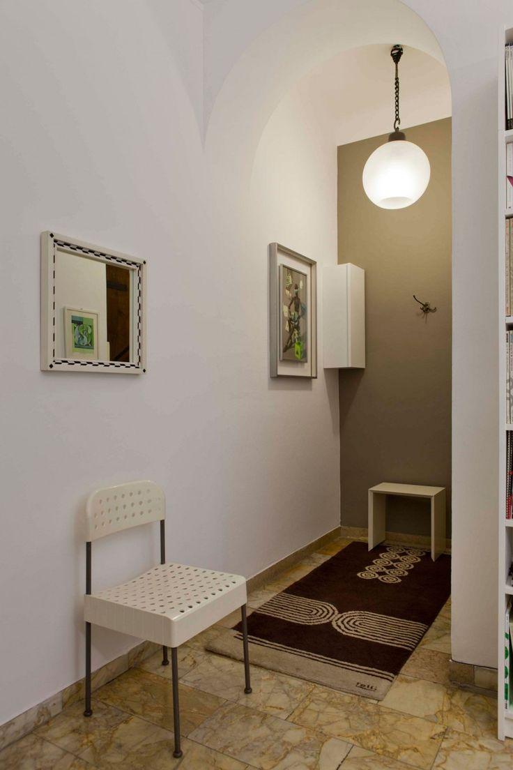 Project all white studio apartment perianth interior design new - Exquisite Studio Design With Vintage Indoor Furniture Small Corner In The Studio Of Antonella Dedini With A Brown Floor And Rounded White L
