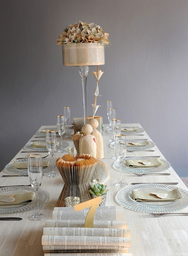 Origami and old folded books can add a touch of vintage to your table decor.  Photos by: Natalie Gabriels. Decor styling & Flowers: DiNique Emporium