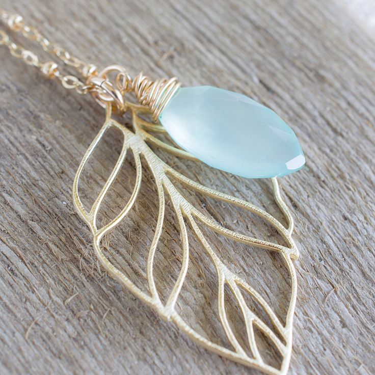 A personal favorite from my Etsy shop https://www.etsy.com/listing/229225740/gold-leaf-necklace-chalcedony-marquis
