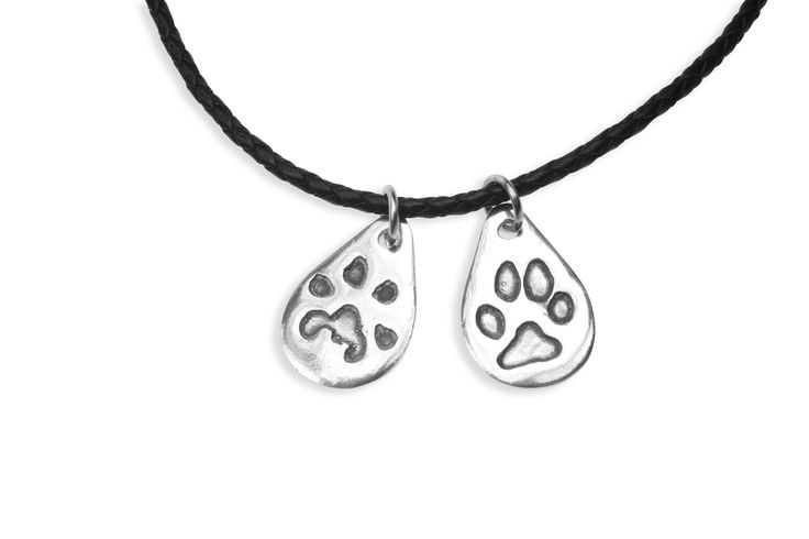 Double paw print pendant on leather   www.silverpetprints.com