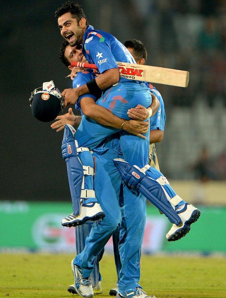 Yuvraj Singh lifts Virat Kohli up after the win in semi