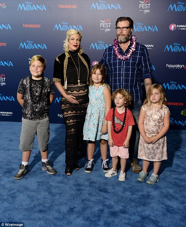 Oh baby! The IRS  has 'drained Tori Spelling and Dean McDermott's bank accounts'... weeks after she welcomes their fifth child; the family are pictured in November